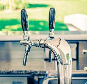 pic of dispenser  - metallic water dispenser with fresh water on bar background - JPG