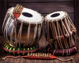 image of bharatanatyam  - Tabla drums and bells for Indian dancing on wooden background - JPG