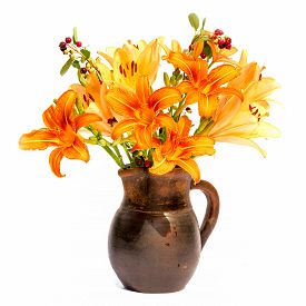 pic of asiatic lily  - Asiatic Hybrids orange lilys bouquet in a brown vase isolated on white background - JPG