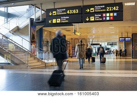VALENCIA, SPAIN - DECEMBER 10, 2016: Airline passengers inside the Valencia Airport. About 4.59 million passengers passed through the airport in 2015.