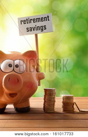 Piggy Bank With Billboard Retirement Savings On Table Nature Vertical