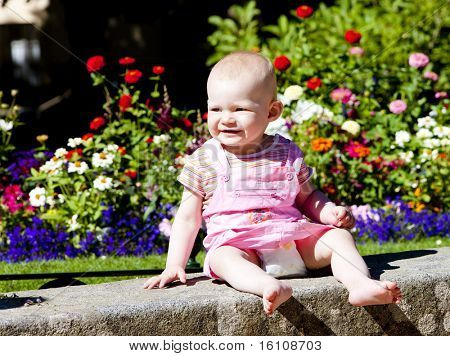 baby girl sitting in the garden
