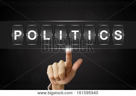 business hand pushing politics on Flipboard Display