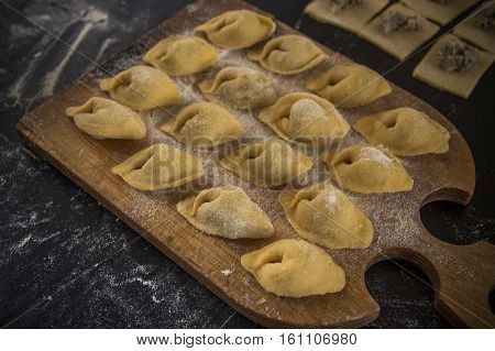 Homemade Tortellini With Mushrooms On Black Background