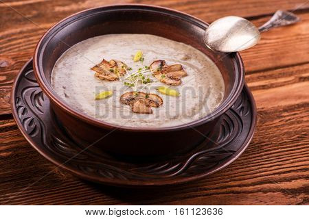 Hearty mushroom soup cream soup with champignons
