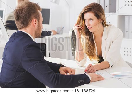 Businesswoman Looking Seductively At Colleague