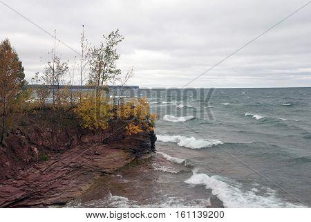 Waves of Lake Superior attack Big Bay Harbor, Big Bay point, Michigan, USA