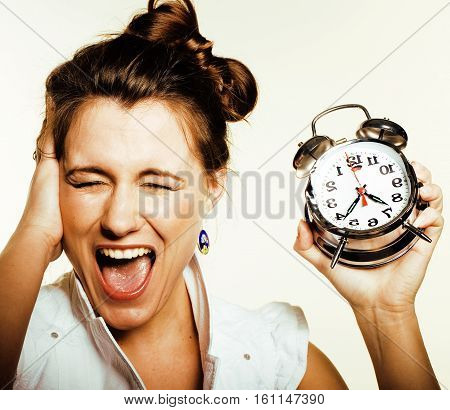 young beauty woman in business style costume waking up for work early morning on white background with clock lifestyle people