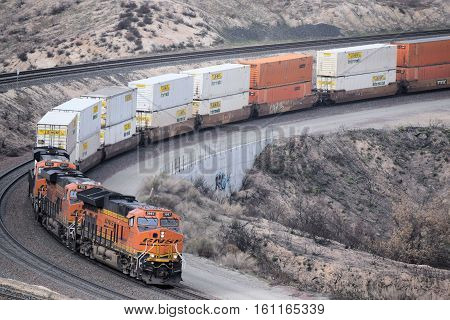 December 11, 2016 in Cajon, CA:  BNSF Freight Train traveling southbound towards Los Angeles transporting commerce to Southern California and beyond taken in the Cajon Pass, CA where railroad enthusiasts have non obstructing views of trains