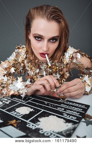 Addicred young woman actress smoking and taking drugs