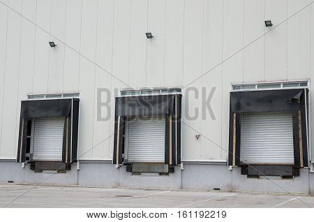 Front view of loading docks of warehouse. Loading platform.