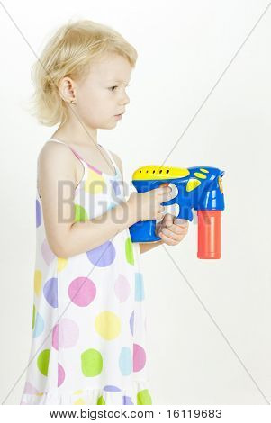 little girl with bubbles maker