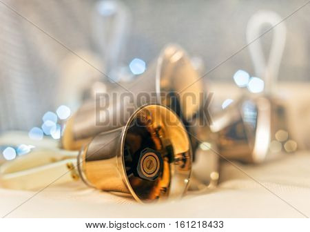 Close-up Of Girl Holding Metal Bell In Hand