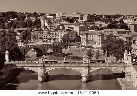 Rome aerial view with ancient architecture, bridge and River Tiber in Italy in monochrome.