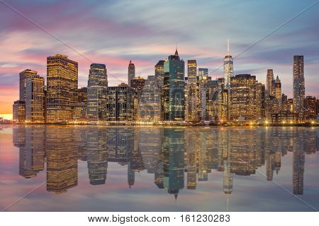 New York City - Famous Manhattan skylines at evening time, with reflections and moody clouds, NYC, USA