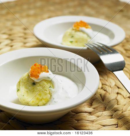 cold potato dumplings with cream and caviar