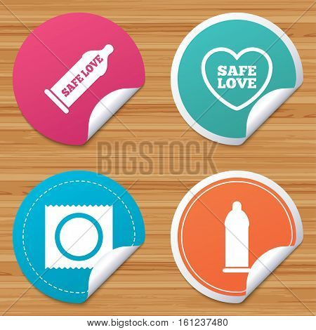 Round stickers or website banners. Safe sex love icons. Condom in package symbol. Fertilization or insemination. Heart sign. Circle badges with bended corner. Vector