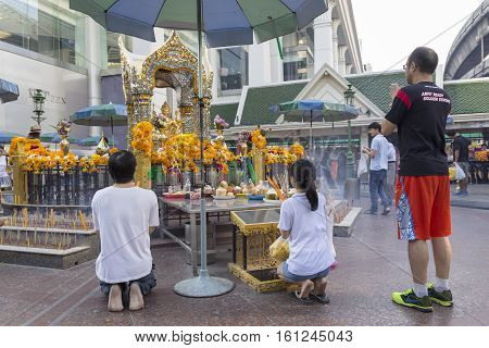 BANGKOKTHAILAND - NOV 26 : Unidentified tourist worship to Erawan shrine at Ratchaprasong Junction on november 26 2016 Thailand. Erawan shrine is famously sacred place in bangkok