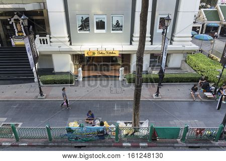 BANGKOKTHAILAND - NOV 26 : life of garland seller near Erawan shrine at Ratchaprasong Junction in morning on november 26 2016. Erawan shrine is famously sacred place in bangkok
