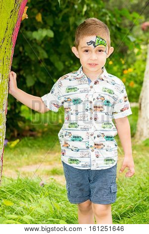 Cute little child boy with akvagrim in park on nature at summer. Use it for baby parenting or love conce