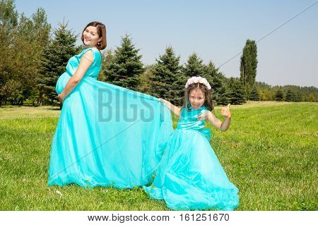 Happy asian mom and child girl hugging. The concept of childhood and family. Beautiful Mother and her baby outdoor