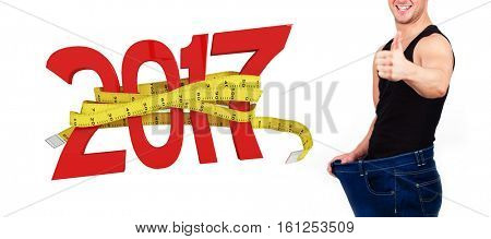 3D Digitally generated image of new year with tape measure against portrait of man happy after losing weight