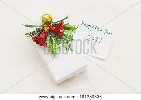 happy new year 2017 message card and box gift on background white