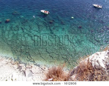 Rocky Beach And Fishing Boat