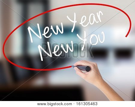 Woman Hand Writing New Year New You With A Marker Over Transparent Board