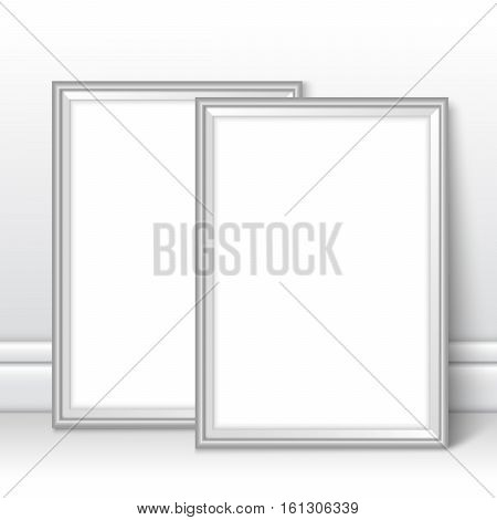 Silver frames template near wall. Grey picture background mock ups. Frames on the floor with realistic shadows. Vector template for presentation your photo art posters photos or other crafts.