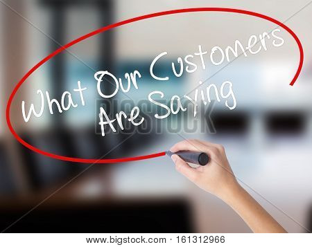 Woman Hand Writing What Our Customers Are Saying With A Marker Over Transparent Board