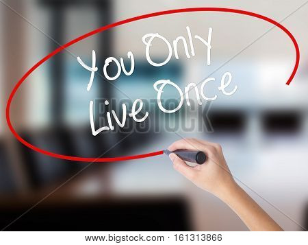 Woman Hand Writing You Only Live Once With A Marker Over Transparent Board