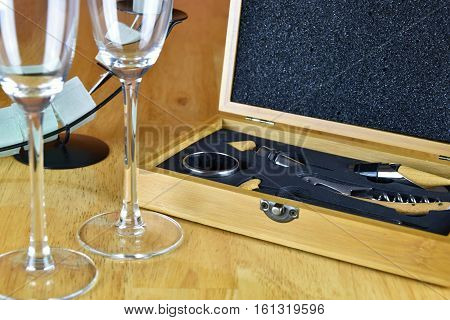 Set of wine in a wooden box. Two glasses of wine and a candlestick. Wine.