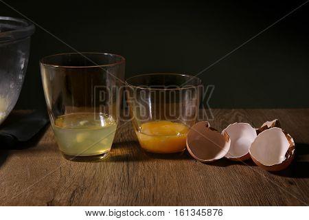 Separated egg white and yolks. Breaken  egg to separate egg white and yolks and egg shells.