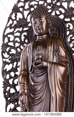 Figure of the standing Buddha with a lotus in a hand and a svastika on a breast.