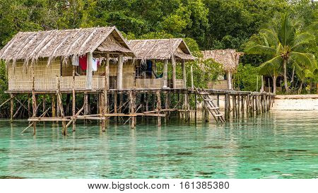 Bamboo Huts on wooden Stocks of an Homestay, Gam Island, West Papuan, Raja Ampat. Indonesia