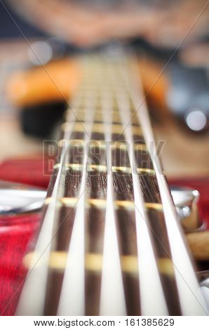 guitar with focus on bottom E string and string-tree.