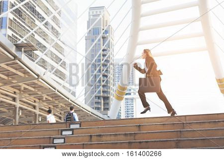 Business Woman  Holding Bag And Running Rapidly To Airport In Formal Suit. In Rush Hour At Stairway
