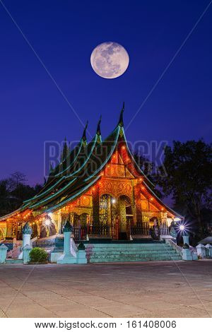 Xieng thong temple is the most popular attractions Luang Phrabang Laos in the evening with a full moon in the sky.