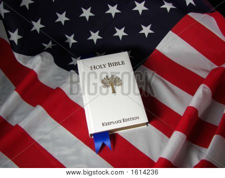 White Bible On American Flag