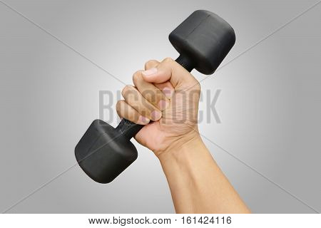 Hands holding dumbbells in sport club or gym and fitness room
