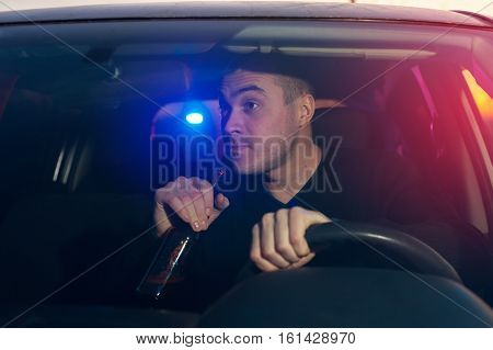 Young drunk driver chased by police while driving car under alcohol influence.