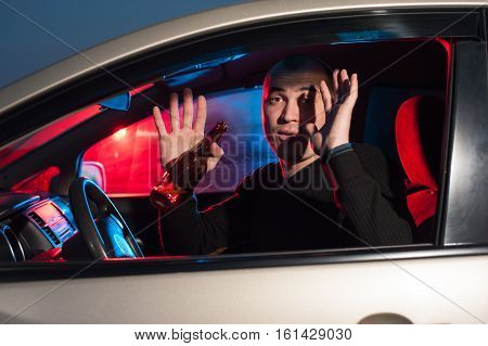 Young Driver With Alcohol Surrendering To Police