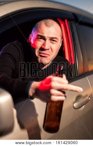 Male Drunk Driver Showing Fuck Gesture