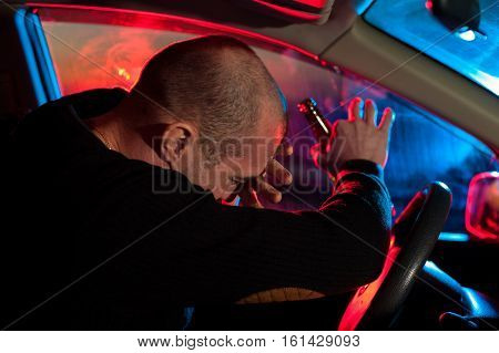 Drunk Driver Covering His Face From Police Light