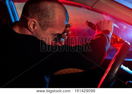 Drunk Driver Covering Face From Police Car Light