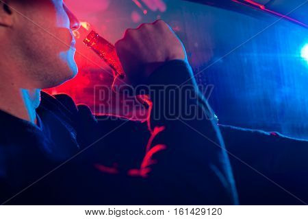 Male Driver On The Background Of Police Lighting