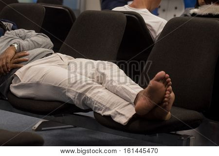 Man sleeps at airport due to delay of flight and long waiting