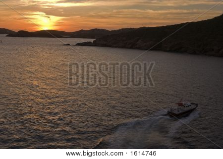 Caribbean Sunset With Boat In Foreground