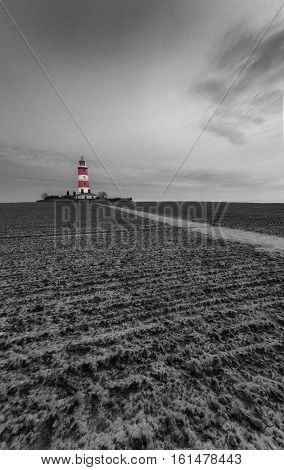 Lighthouse at Happisburgh, Norfolk in black and white with just the lighthouse in colour